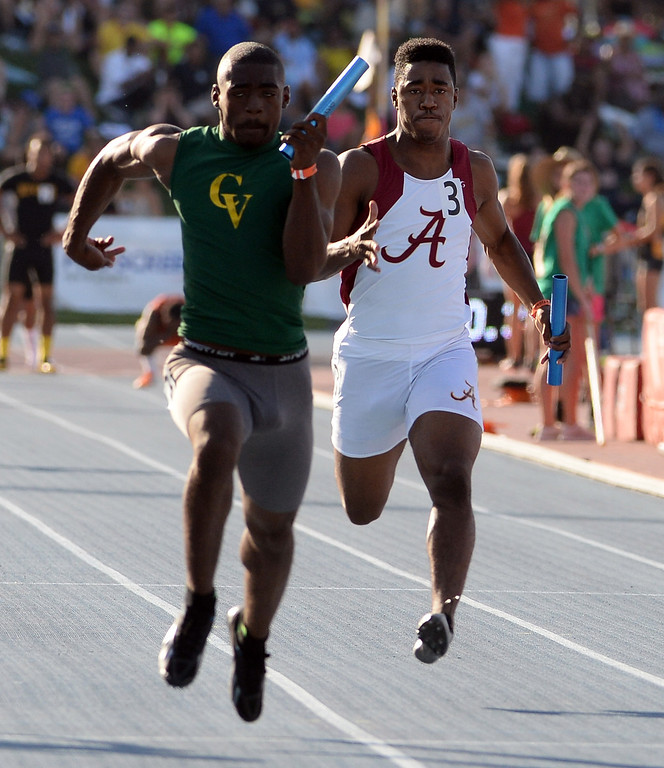 Description of . Alemany's Dominic Davis, right, runs the final leg of the 4x100 meter relay during the CIF California State Track & Field Championships at Veteran's Memorial Stadium on the campus of Buchanan High School in Clovis, Calif., on Saturday, June 7, 2014.   (Keith Birmingham/Pasadena Star-News)