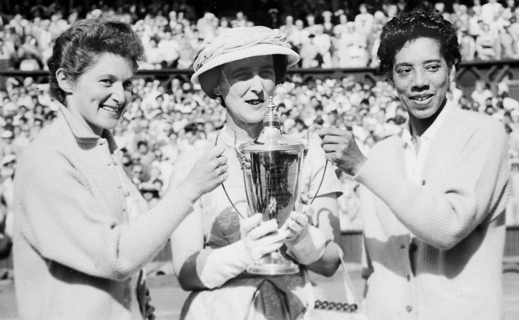 Description of . The Duchess of Kent, center, presents the trophy for the Ladies\' Doubles title to Angela Buxton, left, and Althea Gibson, right, following their victory at Wimbledon, England, July 7, 1956. They defeated the Australian team of Fay Muller and Daphne Seeney, 6-1, 8-6. (AP Photo)