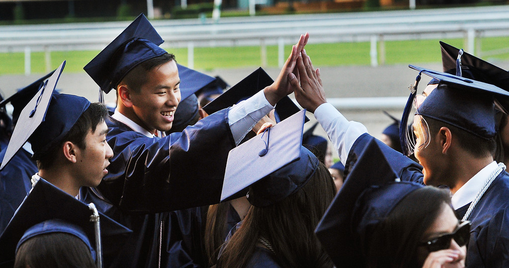 Description of . Gabrielino High in San Gabriel School Class of 2014 graduation was held at Santa Anita Park in Arcadia Wednesday, June 4, 2014.Photo by Walt Mancini/Pasadena Star-News)