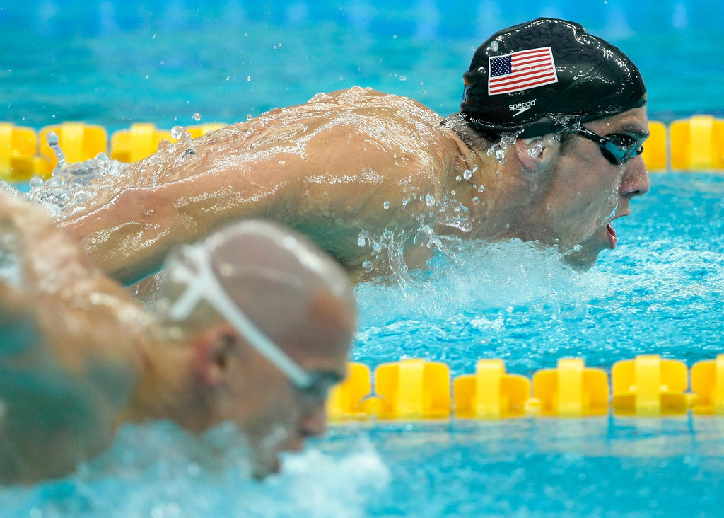 Description of . United States\' Michael Phelps swims on his way to winning the gold medal in the men\'s 400-meter individual medley final during the swimming competitions in the National Aquatics Center at the Beijing 2008 Olympics in Beijing, Sunday, Aug. 10, 2008. Front is Hungary\'s Laszlo Cseh. (AP Photo/Itsuo Inouye)