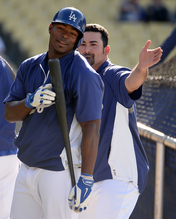 Description of . Los Angeles Dodgers' Yasiel Puig, left, have fun with teammate Adrian Gonzalez prior to a Major league baseball game between the San Diego Padres and the Los Angeles Dodgers on Saturday, July 12, 2014 in Los Angeles.   (Keith Birmingham/Pasadena Star-News)