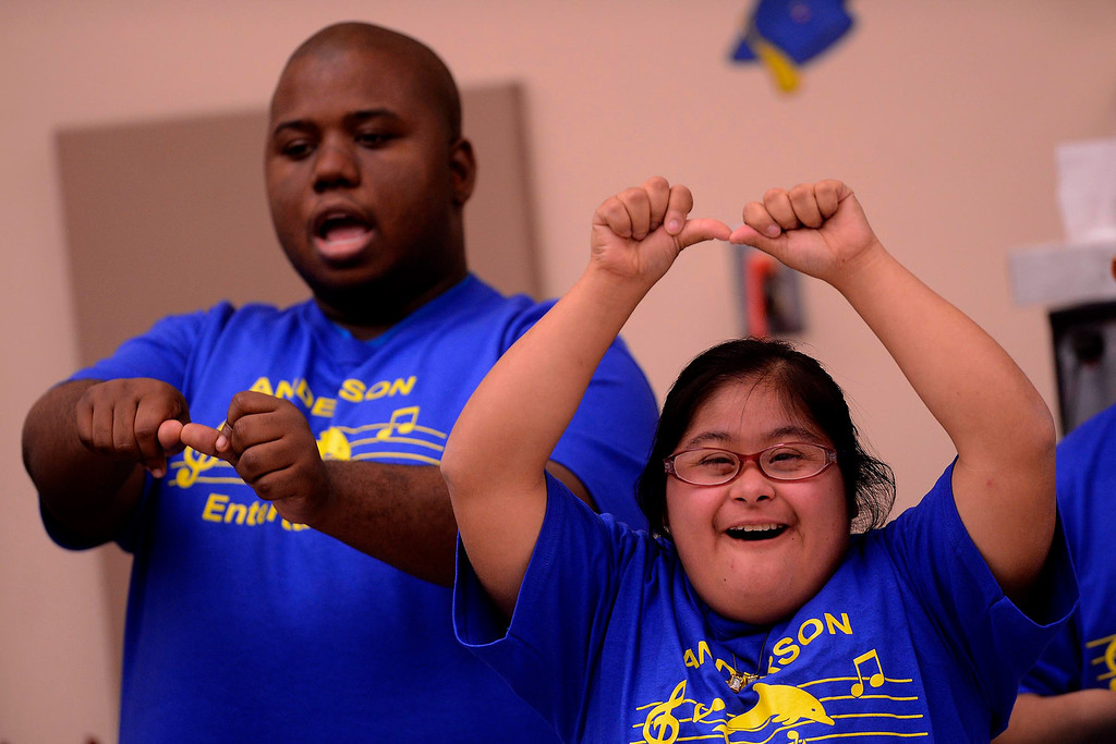 Description of . Daisy Pineda, right, performs with the Anderson Entertainers during Commencement Ceremonies at Carl And Dora Anderson School in San Bernardino May 21, 2013.  Seventeen developmentally disabled students graduated from the school.  GABRIEL LUIS ACOSTA/STAFF PHOTOGRAPHER.
