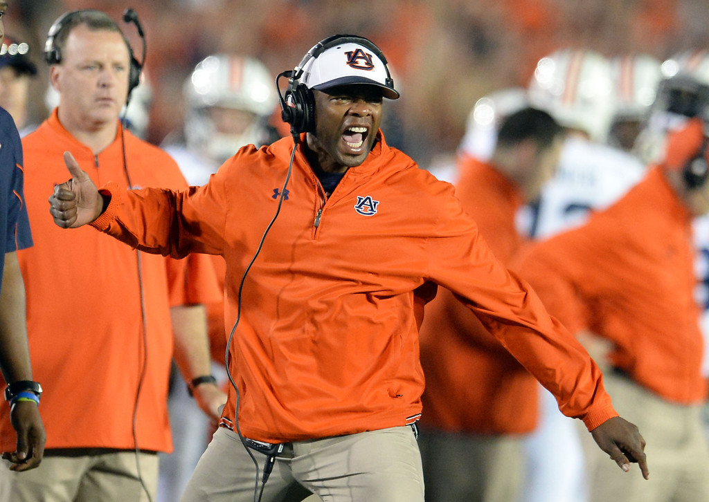 Description of . Auburn coach reacts after scoring against Florida State in the first half of the BCS National Championship game at the Rose Bowl in Pasadena, Calif., on Monday, Jan. 6, 2014. 