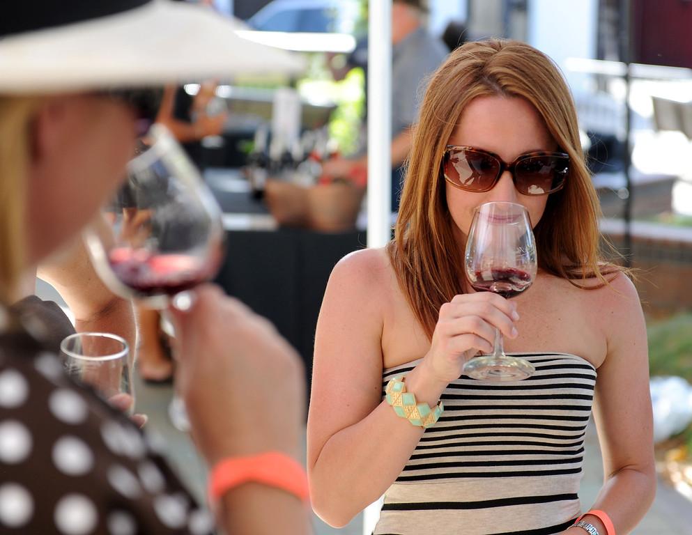 Description of . (John Valenzuela/Staff Photographer)  Jenny Goodell of Redlands enjoys a glass of wine during the Redlands Wine, Beer, and Music event at Ed Hales Park in downtown Redlands, Saturday, June 22, 2013.