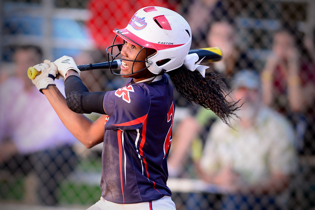 Description of . La Salle's Kinsley Washington (2) makes a hit during the West SGV softball all-star game Wednesday night, June 11, 2014 at Live Oak Park in Temple City. (Photo by Sarah Reingewirtz/Pasadena Star-News)