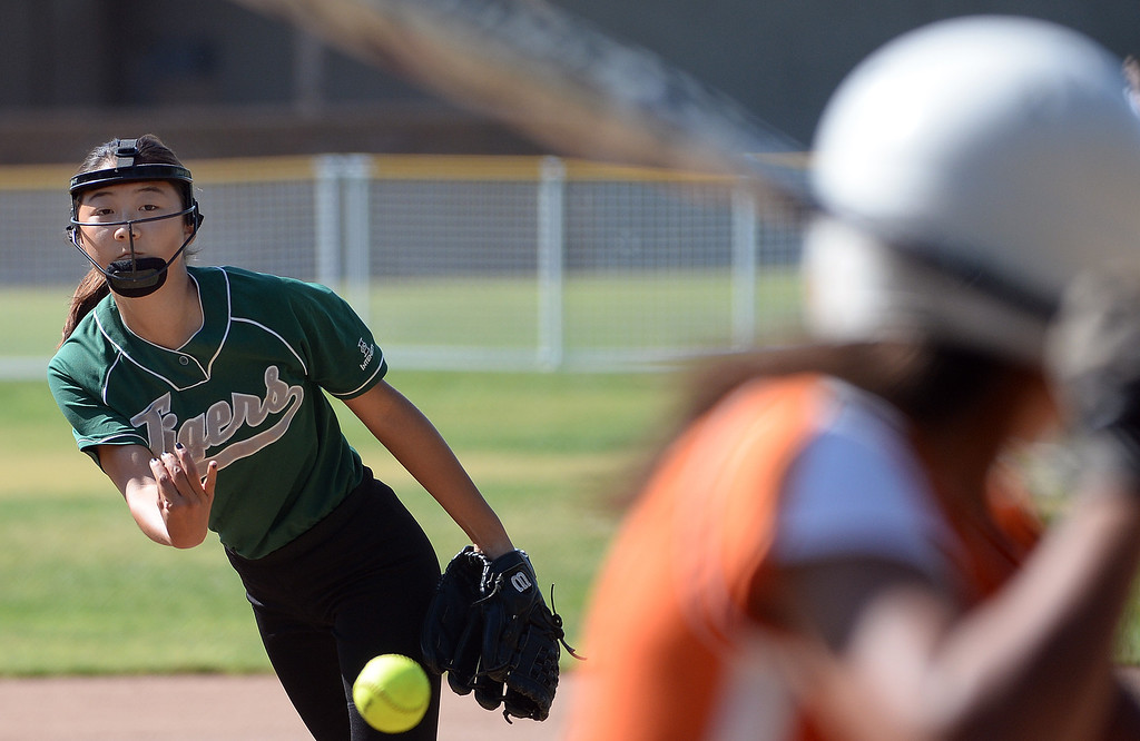 Description of . Westridge starting pitcher Jackie Pai throws to the plate against Poly in the first inning of a prep softball game at Westridge High School in Pasadena, Ca on Tuesday, April 15, 2014. Poly won 11-1. (Keith Birmingham Pasadena Star-News)