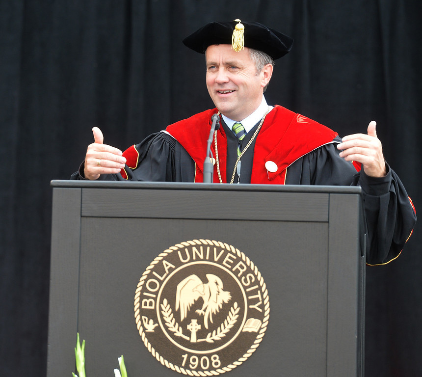 Description of . President Barry Corey speaks during the Commencement Ceremony at Biola University in La Mirada on Friday May 23, 2014. Kay Warren, International speaker and author, gives the commencement address. (Photo by Keith Durflinger/Whittier Daily News)