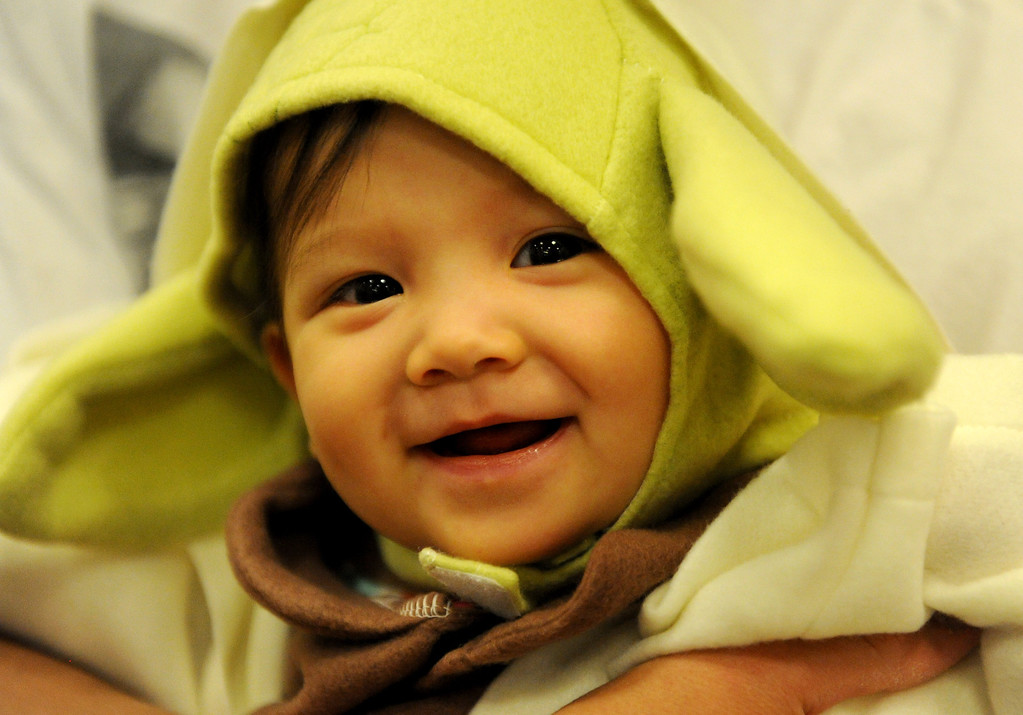 Description of . (John Valenzuela/Staff Photographer) Eight month-old Samantha Chang of Redlands is all smiles in her Yoda costume at Barnes & Noble Bookstore in Redlands during the Star Wars Reads Day, Saturday, Oct. 5, 2013.