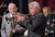 In this photo provided by CBS, former Tonight Show Band leader and members Doc Severinsen ,center, Tommy Newsome, left,  and drummer Ed Shaughnessy, right,  play Johnny Carson's favorite ballad