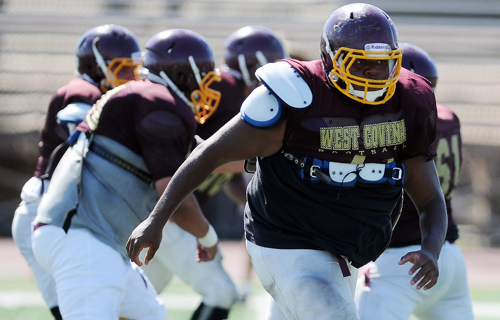 Description of . OL/DL Bryson Finley (71) during football practice at West Covina High School on Tuesday, Aug. 20, 2013 in West Covina, Calif.   (Keith Birmingham/Pasadena Star-News)