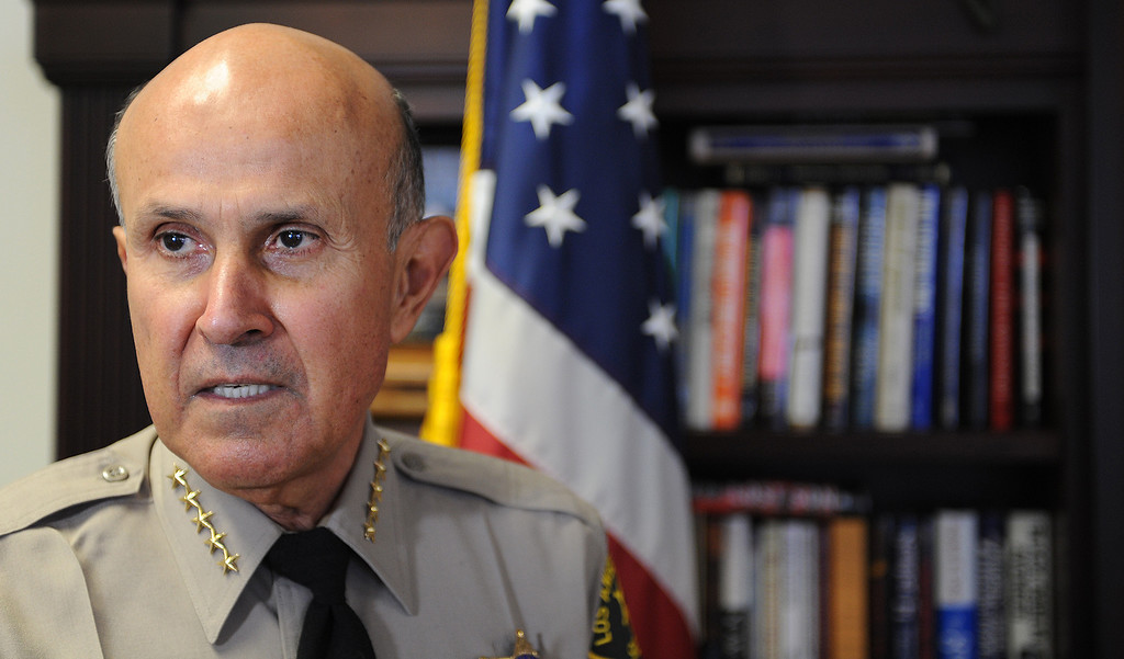 Description of . L.A. County Sheriff Lee Baca will retire at the end of the month after 15 years of leading the largest Sheriff's Department in the nation. He is photographed in his office in Monterey Park, Calif., on Thursday, Jan. 9, 2014. (Photo by John McCoy/Los Angeles Daily News)