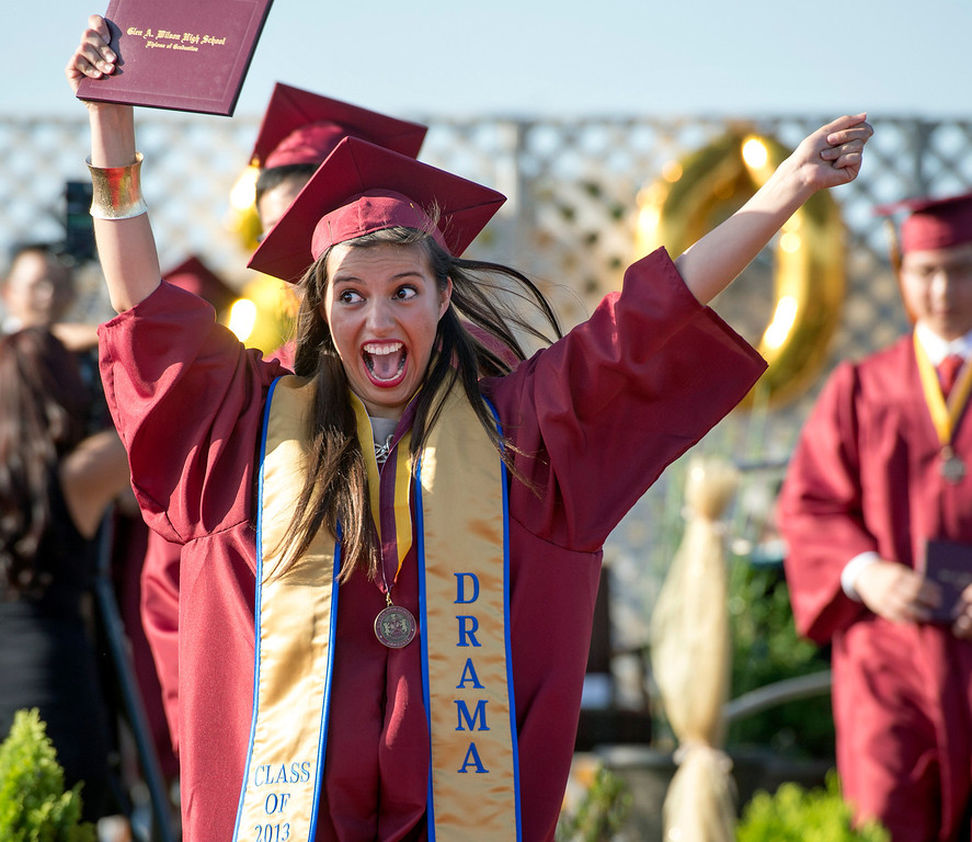 Description of . Wilson High graduate Ingrid Giovanie Ornelas-Gomez exuberantly waves her diploma during the 46th annual commencement exercises at the Hacienda Heights campus May 20, 2013.    (SGV Tribune staff photo by Leo Jarzomb)