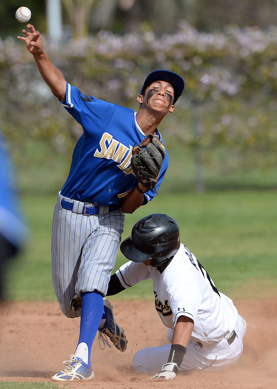 Description of . San Dimas second baseman Matt Corona (6) forces out Northview's Zack Rojo (2) at second base in the third inning of a prep baseball game at Northview High School in Covina, Calif., on Wednesday, March 26, 2014. San Dimas won 2-0.