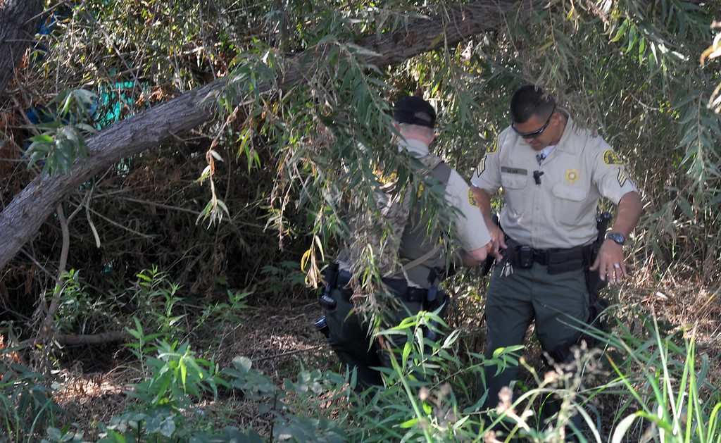 Description of . Los Angeles County Sheriff's Deputies and several County agencies search for homeless individuals camping in the river bed area of the San Gabriel River near South El Monte on Thursday September 12, 2013. (Whittier Daily News/Staff Photo by Keith Durflinger)