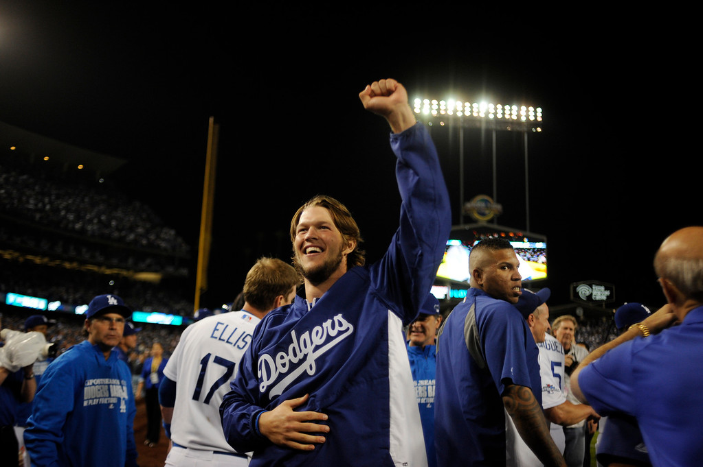 Description of . The Dodgers'  Clayton Kershaw raises his fist in the air after beating  the Atlanta Braves during game 4 of the NLDS at Dodger Stadium Monday, October 7, 2013. The Dodgers beat the Braves 4-3.(Photo by Hans Gutknecht/Los Angeles Daily News)