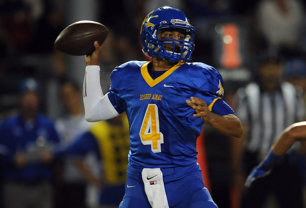Description of . Bishop Amat quarterback Koa Haynes (C) passes against Charter Oak in the first half of a prep football game at Bishop Amat High School in La Puente, Calif. on Friday, Sept. 20, 2013.    (Photo by Keith Birmingham/Pasadena Star-News)