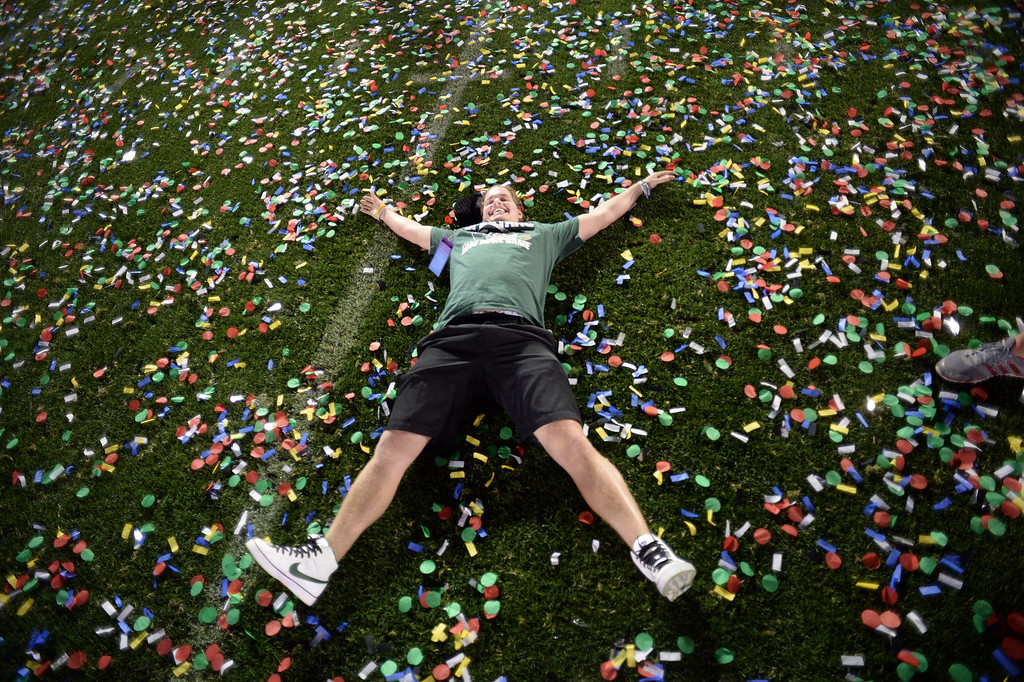 Description of . Michigan State fan Ryan Rafac lays on the field after Michigan State won the 100th Rose Bowl game in Pasadena Wednesday, January 1, 2014. Michigan State defeated Stanford 24-20. (Photo by Hans Gutknecht/Los Angeles Daily News)