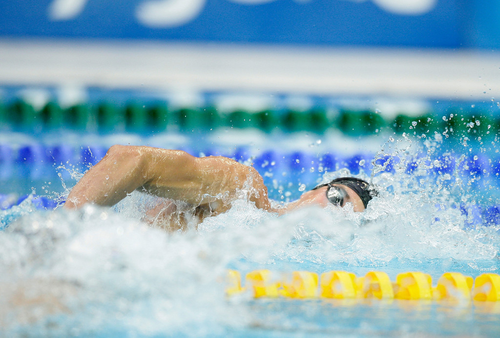 Description of . United States Michael Phelps is seen in action during the men\'s 200-meter freestyle final during the swimming competitions in the National Aquatics Center at the Beijing 2008 Olympics in Beijing, Tuesday, Aug. 12, 2008.  Phelps won gold. (AP Photo/David J. Phillip)