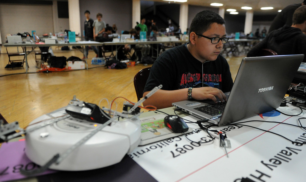 Description of . Fourteen year-old Ryan Ramirez of La Puente High School works on his robot software during the Botball Regional Tournament, part of standards-based educational robotics program. Part of a national program to encourage kids to study math, science. Kids from schools in LA County will compete to see who built best robot at the Shrine Expo Hall on Saturday, March 4, 2013 in Los Angeles.    (Keith Birmingham Pasadena Star-News)