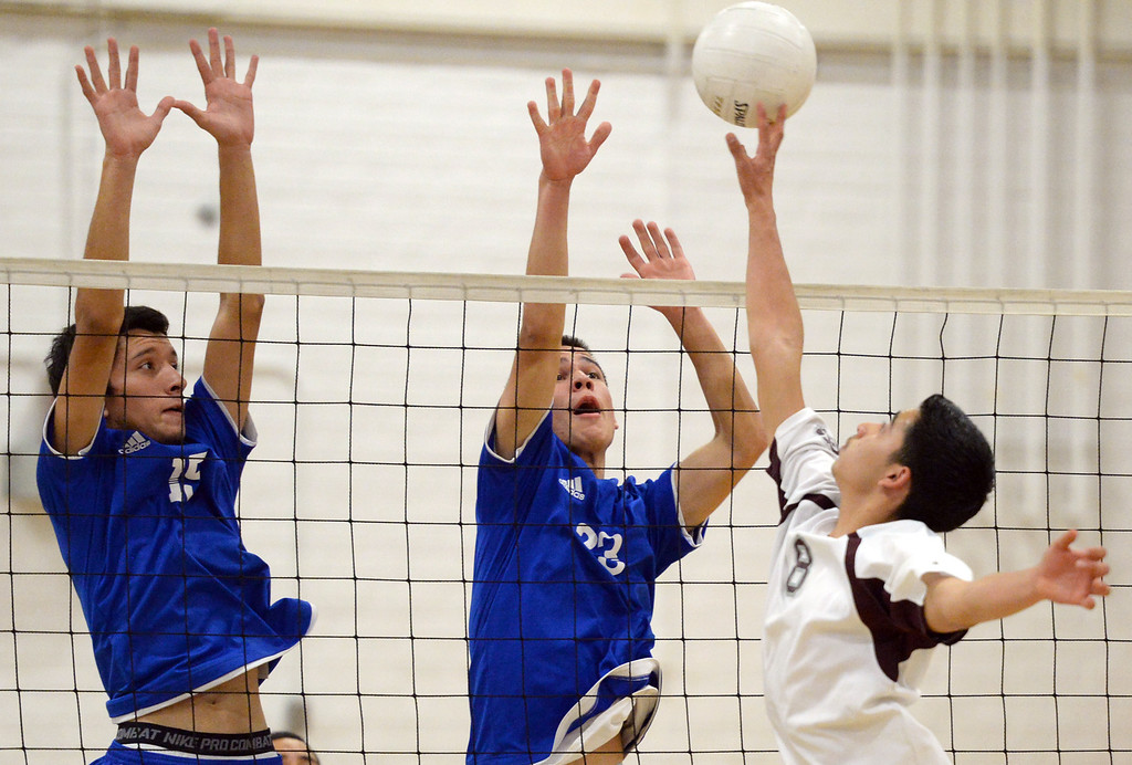 Description of . El Rancho's Bryan Rojas (#15) and Dimitric Lozano (#23) jump up to block a shot as they play Bell Gardens in their non-league game at El Rancho High School in Pico Rivera on Friday March 28, 2014. Bell Gardens defeated El Rancho 3-2 games. (Staff Photo by Keith Durflinger/Whittier Daily News)