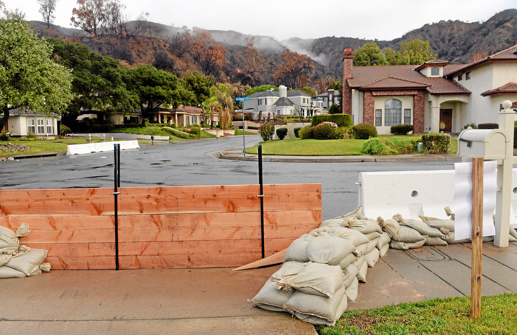 Description of . Sanbags, K-rails and wood barriers are in place at Englewild Drive and Rose Drive in Glendora in preparation of the oncoming storm on Thursday February 27, 2014. (Staff Photo by Keith Durflinger/San Gabriel Valley Tribune)