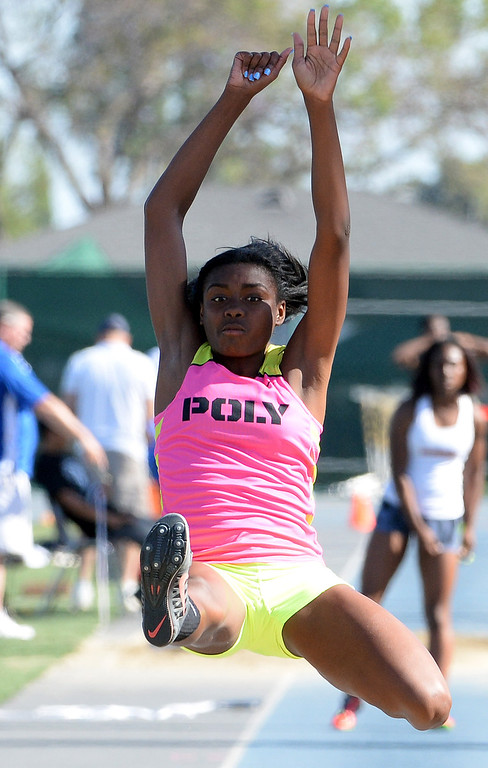 Description of . Long Beach Poly's Zhane Smith competes in the long jump during the CIF-SS Masters Track and Field meet at Falcon Field on the campus of Cerritos College in Norwalk, Calif., on Friday, May 30, 2014.   (Keith Birmingham/Pasadena Star-News)