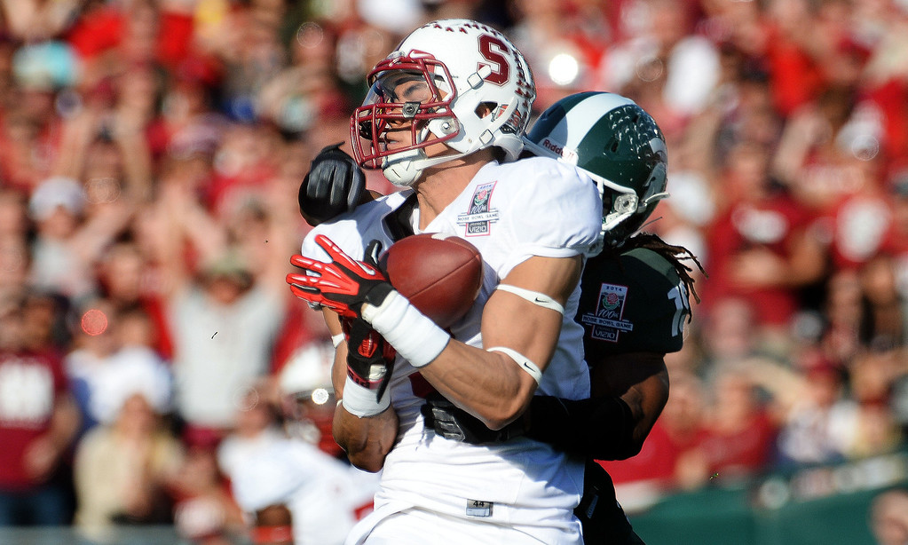 Description of . Stanford wide receiver Michael Rector catches a 43 yard pass play for a first down against Michigan State in the first half of the 100th Rose bowl game in Pasadena, Calif., on Wednesday, Jan.1, 2014. 