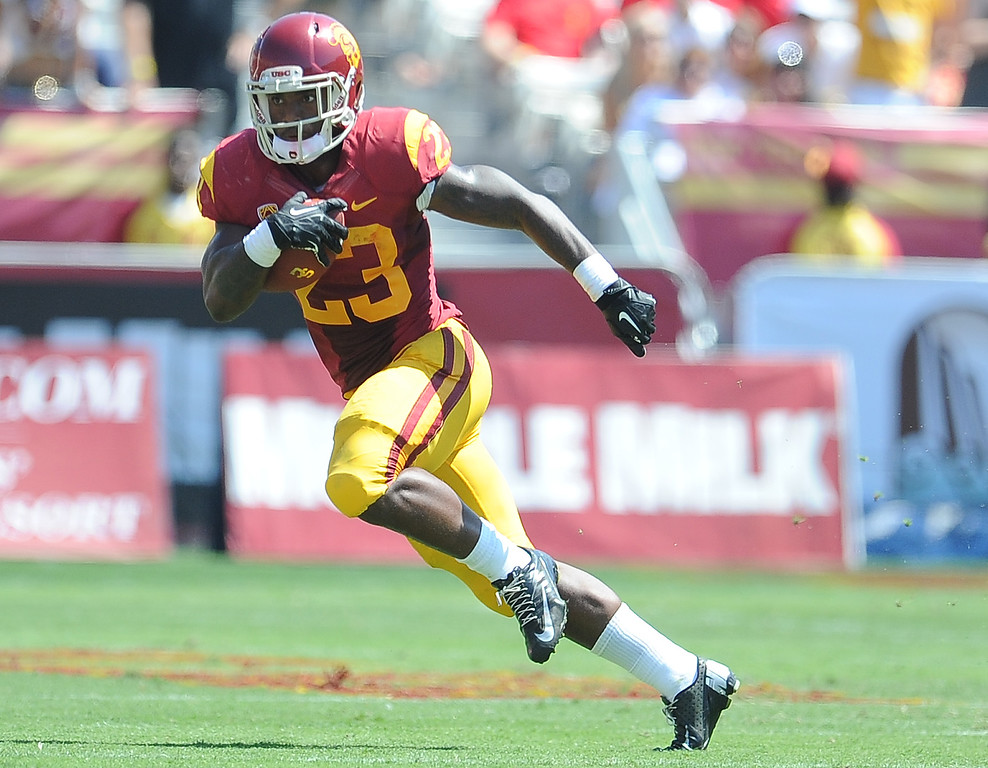 Description of . Southern California running back Tre Madden (23) against Boston College during the first half of an NCAA college football game in the Los Angeles Memorial Coliseum in Los Angeles, on Saturday, Sept. 14, 2013.