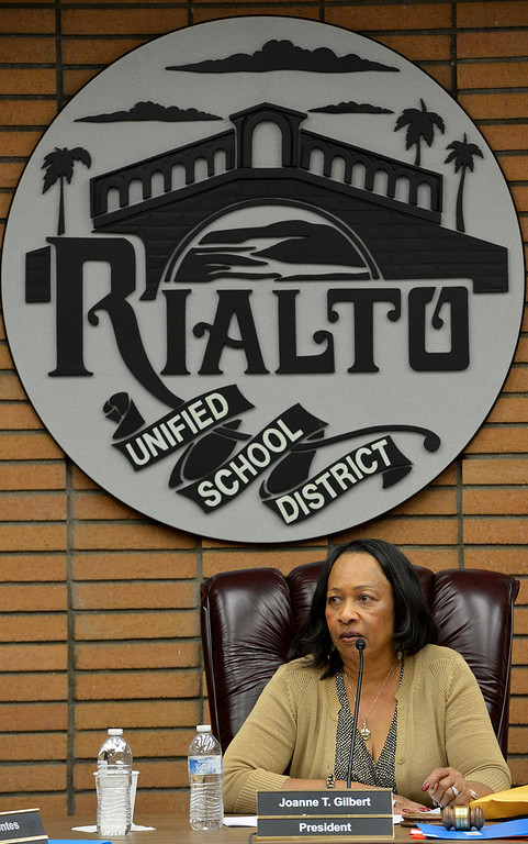 Description of . The Rialto Unified school board, president Joanne Gilbert pictured here, accepted the retirement of embattled superintendent Harold Cebrun on Friday March 7, 2014 saving the district 18 months of salary, $360,900, that they would have owed him if he were fired. The 4-1 vote after two hours of closed-door discussion makes his retirement effective March 31. Board member Edgar Montes was the one dissenting vote in accepting Cebrun's retirement. (Photo by Rick Sforza/The Sun)