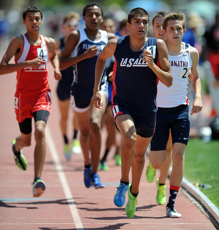 Description of . La Salle's Daniel De La Torre wins the 1600 meter race during the CIF-SS track & Field championship finals in Hilmer Stadium on the campus of Mt. San Antonio College on Saturday, May 18, 2013 in Walnut, Calif.  (Keith Birmingham Pasadena Star-News)