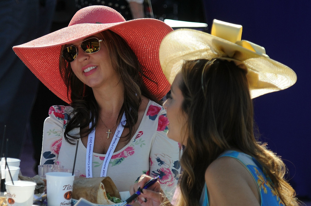 Description of . Race fan wearing colorful hats look on during the seventh race during the Breeders' Cup at Santa Anita Park in Arcadia, Calif., on Saturday, Nov. 2, 2013.    (Keith Birmingham Pasadena Star-News)