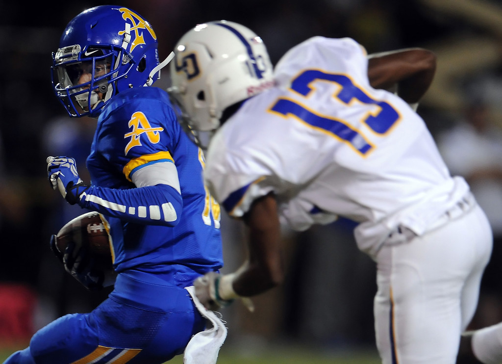 Description of . Bishop Amat's Trevon Sidney (18) intercepts a Charter Oak pass ahead of Dareon Nash (13) in the first half of a prep football game at Bishop Amat High School in La Puente, Calif. on Friday, Sept. 20, 2013.    (Photo by Keith Birmingham/Pasadena Star-News)