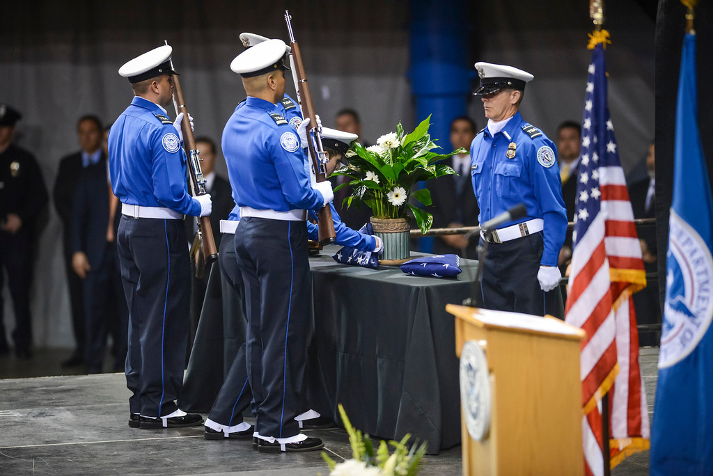 Description of . The flag for slain TSA officer Gerardo Hernandez is presented by TSA officers at the memorial at the Los Angeles Sports Arena Tuesday, November 12, 2013.  A public memorial was held for Officer Hernandez who was killed at LAX when a gunman entered terminal 3 and opened fire with a semi-automatic rifle, Grigsby was wounded in the attack.  ( Photo by David Crane/Los Angeles Daily News )