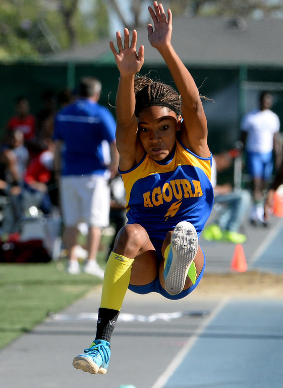 Description of . Agoura's Tara Davis competes in the long jump during the CIF-SS Masters Track and Field meet at Falcon Field on the campus of Cerritos College in Norwalk, Calif., on Friday, May 30, 2014.   (Keith Birmingham/Pasadena Star-News)