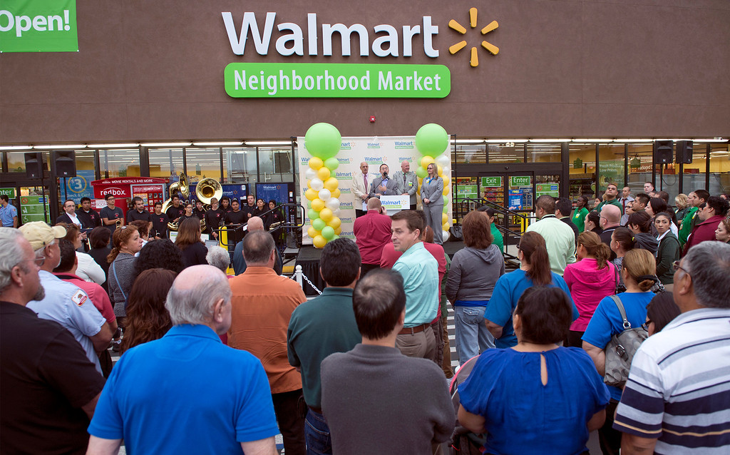 Description of . Walmart staff, La Puente officials and members of the public attend the grand opening of Walmart Neighborhood Market at 1425 N. Hacienda Boulevard in La Puente, Calif. October 2, 2013.  (Staff photo by Leo Jarzomb/SGV Tribune)