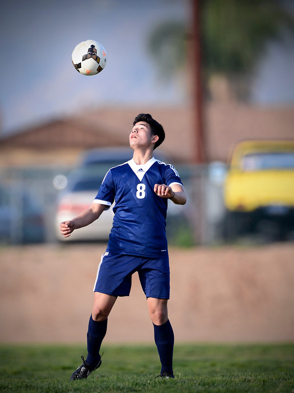 Description of . Baldwin Park's Andy Castillo (8) controls the ball as they defeat Northview 2-0 during Tuesday's game at Northview High School, February 11, 2014. (Photo by Sarah Reingewirtz/Pasadena Star-News)