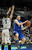 Florida Gulf Coast's Brett Comer, right, looks to pass under pressure from Georgetown's Mikael Hopkins during the first half of a second-round game of the NCAA college basketball tournament, Friday, March 22, 2013, in Philadelphia. (AP Photo/Michael Perez)