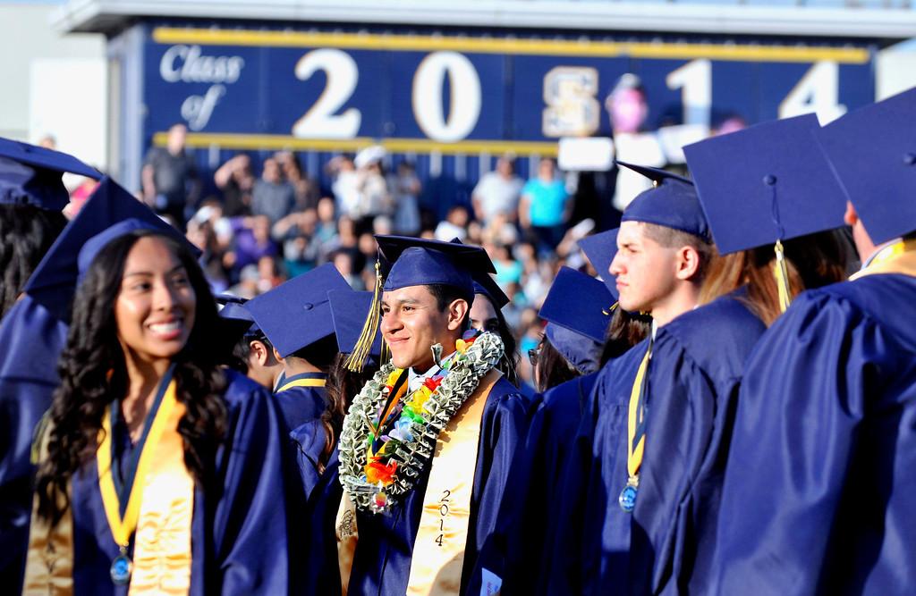 Description of . South El Monte High School Graduation on their football stadium, Wednesday, June 11,  2014.  (Mike Mullen photo)