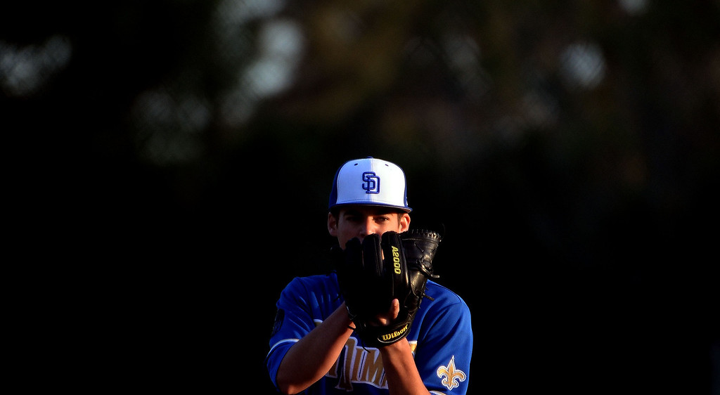 Description of . San Dimas starting pitcher Peter Lambert (C) eyes the plate against Bonita in the first inning of a prep baseball game at Bonita High School in La Verne, Calif., on Wednesday, March 19, 2014.  (Keith Birmingham Pasadena Star-News)