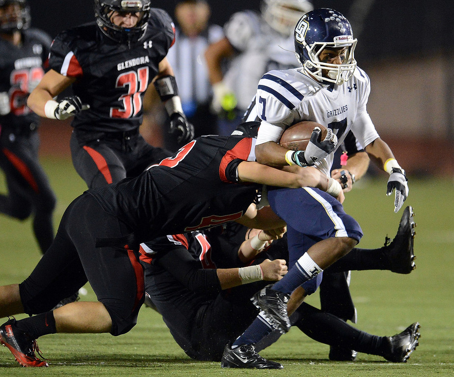 Description of . Los Osos' Malcolm Smith (7) runs for a first down against Glendora in the first half of a prep football game at Citrus College in Glendora, Calif., on Thursday, Oct. 31, 2013.    (Keith Birmingham Pasadena Star-News)