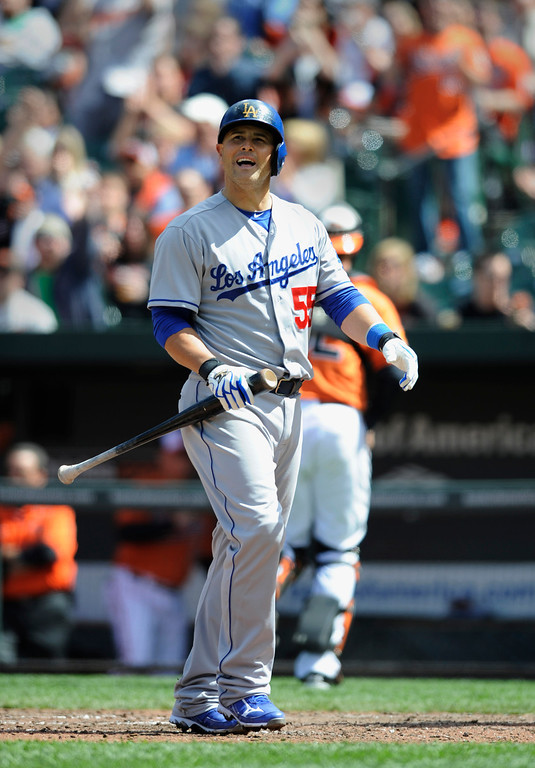 Description of . Los Angeles Dodgers Ramon Hernandez reacts after striking out with the bases loaded against the Baltimore Orioles in the fifth inning of the first baseball game of a doubleheader Saturday, April 20, 2013, in Baltimore. Orioles won 7-5  (AP Photo/Gail Burton)