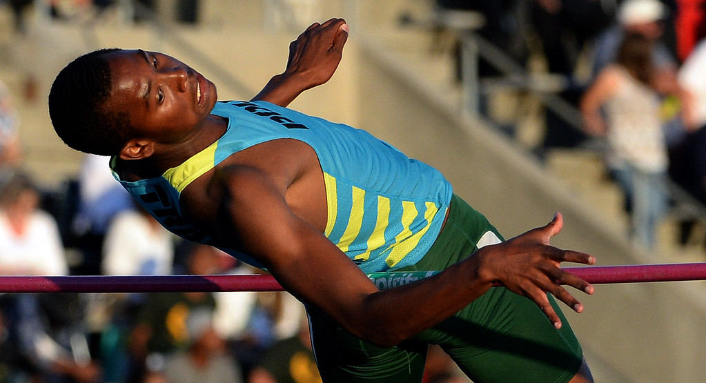 Description of . Pasadena Poly's Vincent Calhoun competes in the high jump during the CIF-SS Masters Track and Field meet at Falcon Field on the campus of Cerritos College in Norwalk, Calif., on Friday, May 30, 2014.   (Keith Birmingham/Pasadena Star-News)