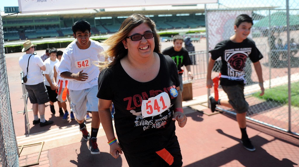Description of . Runners start the race during the Zombie Blood Run at Santa Anita Park on Saturday, Aug. 17, 2013 in Arcadia, Calif. The American Red Cross San Gabriel Pomona Valley chapter is partnering with the Zombie Blood Run to prepare the San Gabriel Valley for a disaster, even a zombie apocalypse.  (Keith Birmingham/Pasadena Star-News)