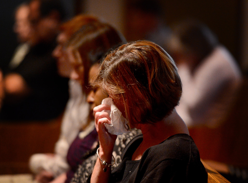 Description of . A woman wipes her eyes during a memorial for April Jace at Biola University's Calvary Chapel Tuesday, May 20, 2014 after Los Angeles Police said they arrested actor Michael Jace on suspicion that he shot and killed his wife. April was a financial aid counselor at the La Mirada college. (Photo by Sarah Reingewirtz/Pasadena Star-News)