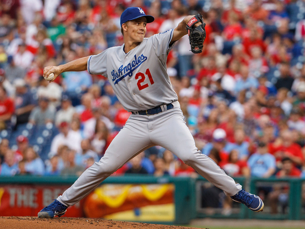 Description of . Los Angeles Dodgers starting pitcher Zack Greinke throws to the Philadelphia Phillies during the first inning of a baseball game on Friday, Aug. 16, 2013, in Philadelphia. (AP Photo/Christopher Szagola)