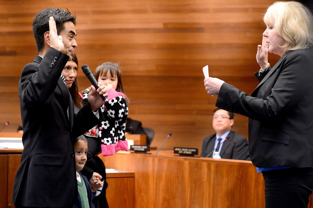 Description of . James Toma is sworn in for a seat on the West Covina City Council Tuesday night, December 3, 2013. (Photo by Sarah Reingewirtz/Pasadena Star-News)