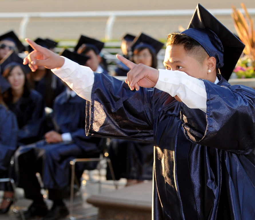Description of . Nikko Angelo Delavin walking to obtain his diploma. Gabrielino High in San Gabriel School Class of 2014 graduation was held at Santa Anita Park in Arcadia Wednesday, June 4, 2014.Photo by Walt Mancini/Pasadena Star-News)