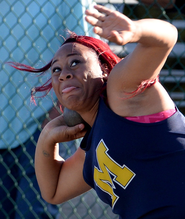 Description of . Muir's Tierra Adams competes in the shop put during the CIF-SS Masters Track and Field meet at Falcon Field on the campus of Cerritos College in Norwalk, Calif., on Friday, May 30, 2014.   (Keith Birmingham/Pasadena Star-News)