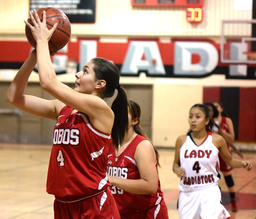 Description of . Workman's Raquel Ramirez (4) drives to the basket against Gladstone in the first half of a prep basketball game at Gladstone High School in Covina, Calif., on Friday, Jan. 17, 2014. (Keith Birmingham Pasadena Star-News)
