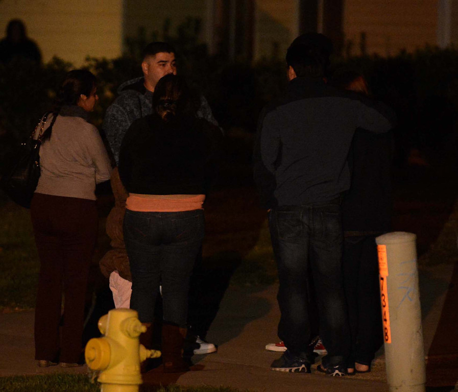 Description of . Friends and family members getherd outside of a home in the 7300 block of Palmetto Avenue in Fontana Tuesday  December 31, 2023  after four dead bodies were found inside a home late Monday evening. (Staff photo by LaFonzo Carter/The Sun)